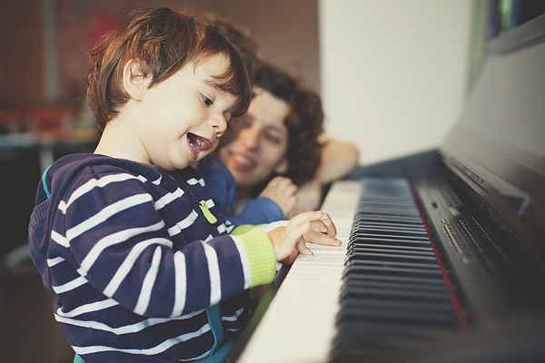 Small boy playing piano Photograph by Thanasis Zovoilis