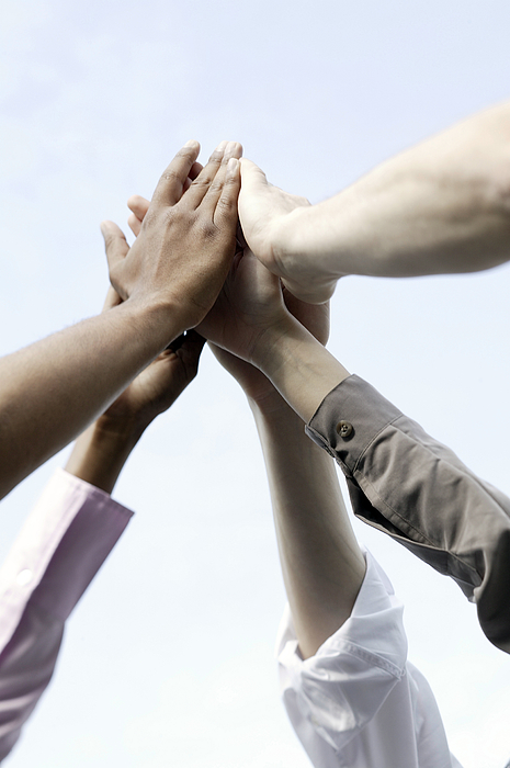 Small Group Of People Giving High-five Photograph by Comstock