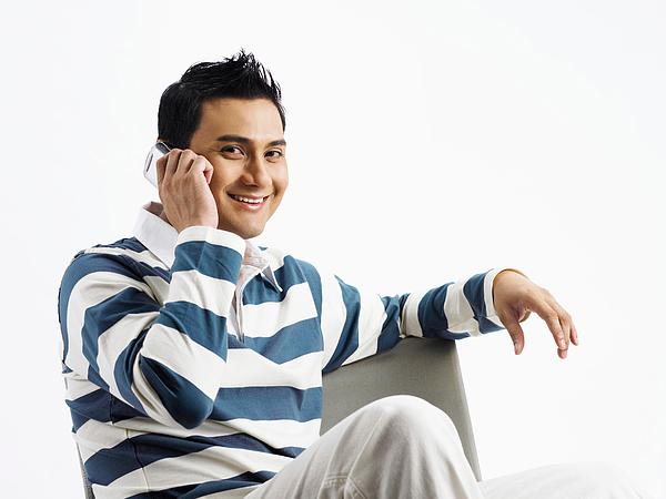 Smiling Man Using Phone Against White Background Photograph by Eskay Lim / EyeEm