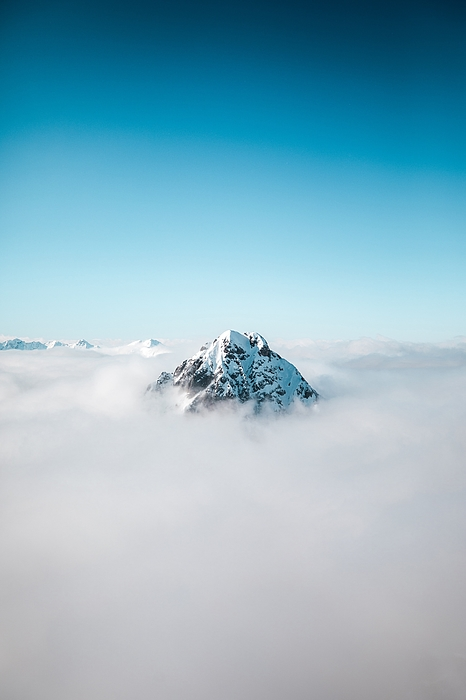 Snowcapped Mountain Amidst Clouds Against Sky Photograph by Florian Konrad / EyeEm