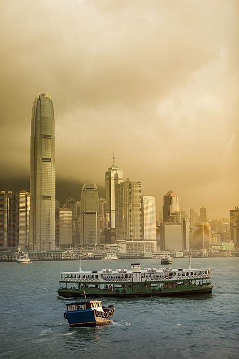 Star Ferry during sunrise Photograph by Merten Snijders