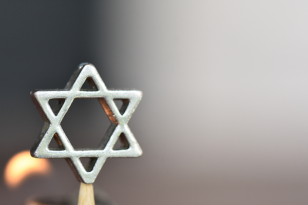 Star of David on a candle background Photograph by tzahiV