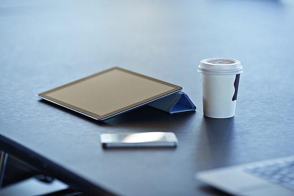 Still-life of tablet, to-go coffee & phone Photograph by Klaus Vedfelt