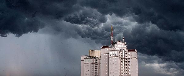 Storm Clouds Above Skyscraper Photograph by Aditia Patria W / EyeEm