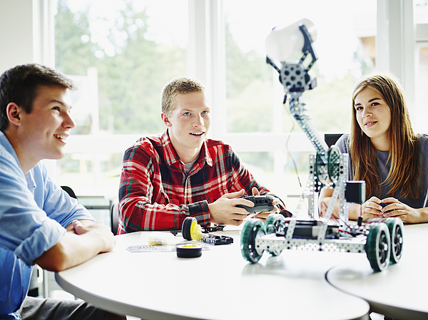 Student using remote control to operate robot Photograph by Thomas Barwick