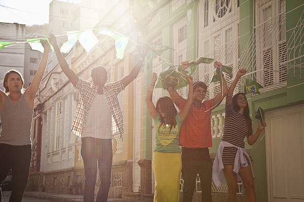 Students celebrating with Brazilian flags in the street, Rio de Janeiro, Brazil Photograph by Jag Images
