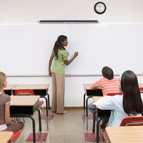 Students listening to teacher in classroom Photograph by Monashee Frantz