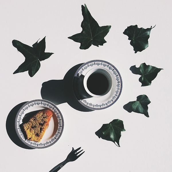 Studio Shot Of Coffee Cup And Cake Surrounded By Ivy Leaves Photograph by Francesco Nacchia / EyeEm