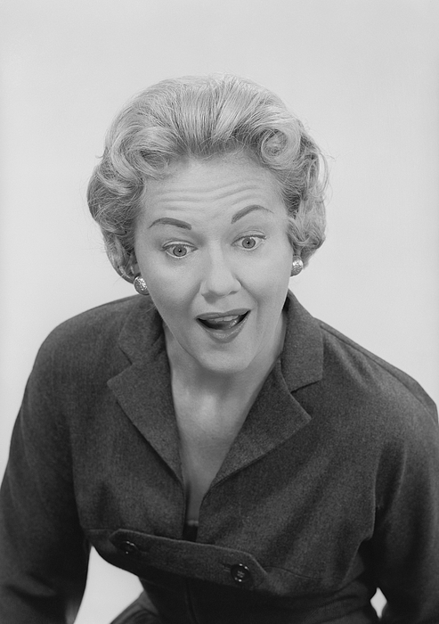 Studio shot of mid adult woman with facial expression Photograph by George Marks