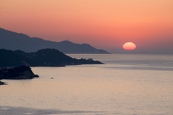 Sunset in the Aegean sea Photograph by George Pachantouris