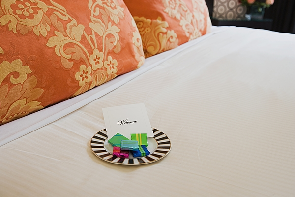 Sweets on a hotel bed Photograph by Image Source
