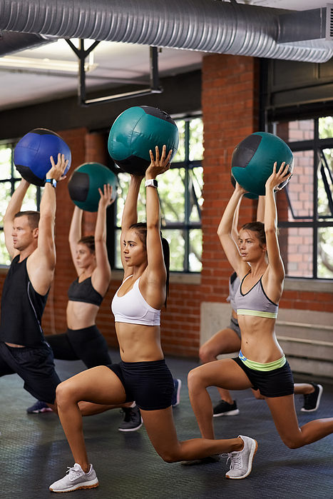 Taking a fitness class together Photograph by Jeffbergen