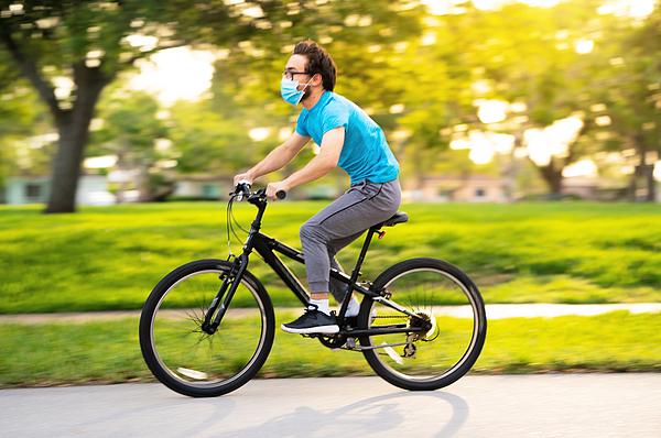 Teenager cycling on the neighborhood Photograph by Thepalmer