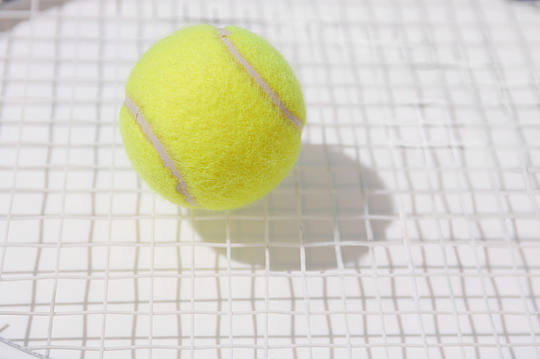 Tennis Ball and Racket Photograph by Hideki Yoshihara/Aflo