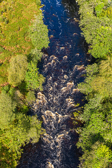 The aerial view looking straight down at a river in remote rural Dumfries and Galloway Photograph by JohnFScott
