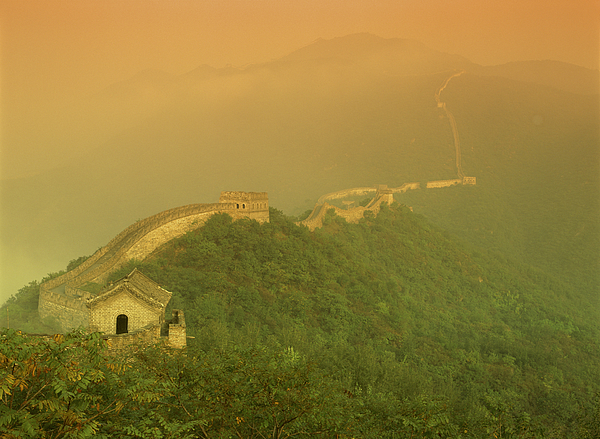 The Great Wall Of China With A Warm Yellow Sky Photograph by Rubberball