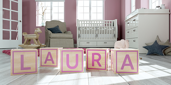The name laura written with wooden toy cubes in childrens room Photograph by Virtua73