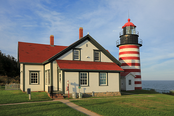 The Red-and-white Striped West Quoddy Head Lighthouse In Maine Photograph by Rainer Grosskopf