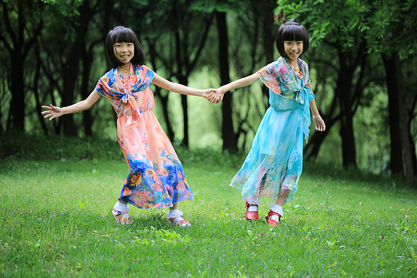 The twin sisters dance in the woods Photograph by Bin Cai