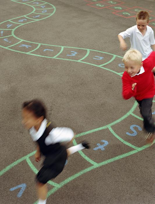 Three Children (6-8) Running In Playground (blurred Motion) Photograph by Digital Vision