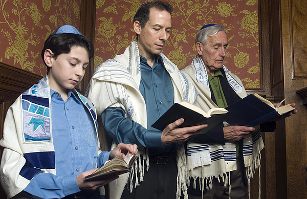 Three Generations Reading from the Torah Photograph by Leland Bobbe