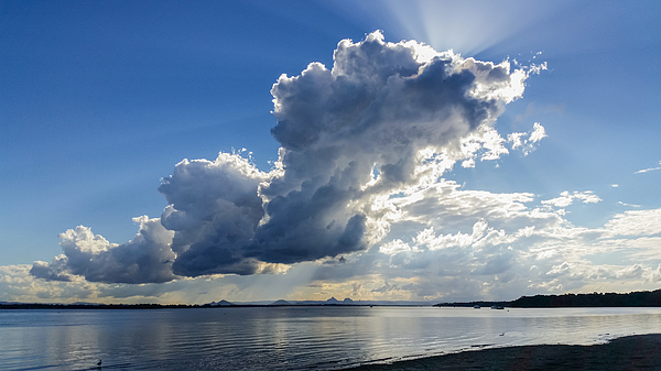 Thundercloud over Pumicestone Passage from Bribie Island in Queensland Australia looking over water toward the Glasshouse mountains Photograph by Susan Vineyard