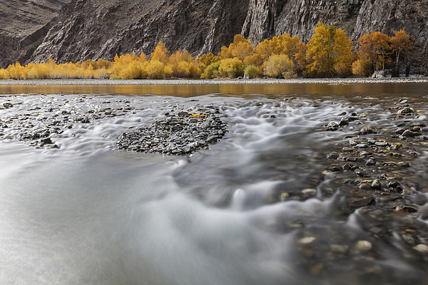 Time lapse view of river and rocky riverbed in remote landscape Photograph by Jeremy Woodhouse