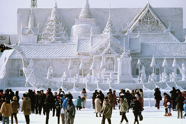 Tourist in front of a snow sculpture, Bangkoks Royal Palace, Snow Festival, Sapporo, Japan Photograph by Glowimages