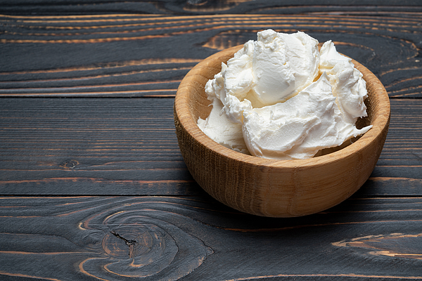 Traditional Mascarpone cheese in wooden bowl on table Photograph by Repinanatoly