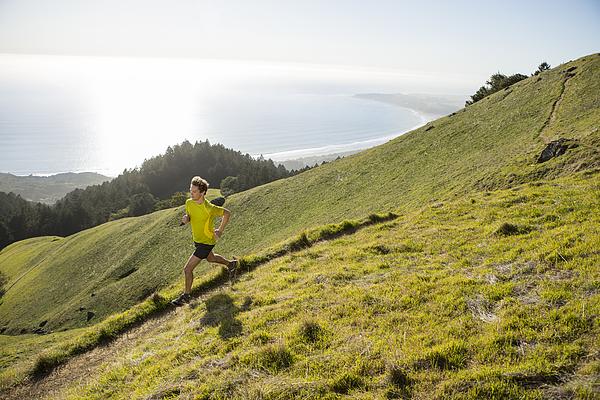 Trail running above the ocean. Photograph by Jordan Siemens