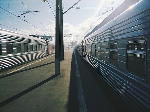 Trains At Railroad Station Against Sky Photograph by Artur Shustrov / EyeEm