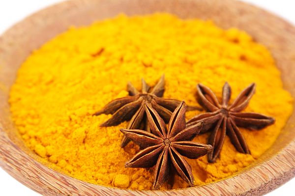 Turmeric in a bowl Photograph by Visage