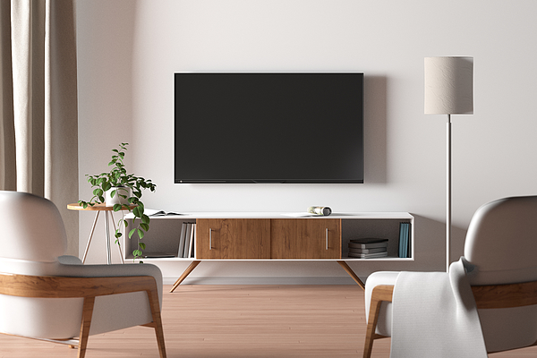 TV screen on the white wall in modern living room. Photograph by Dmitriymoroz