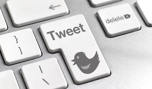 Tweet button on keyboard Photograph by Peter Dazeley