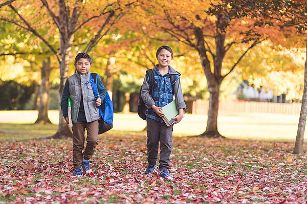 Two Elementary-age Boys Walk To School Through The Park Photograph by FatCamera