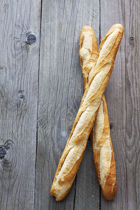 Two French Baguettes On Grey Wood Photograph by Westend61