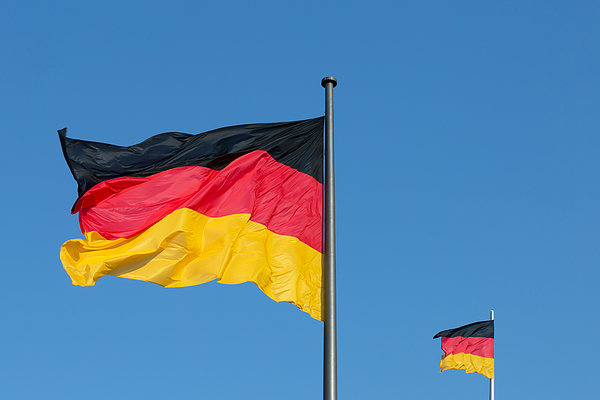 Two German Flags With Blue Sky (berlin, Germany) Photograph by Fhm