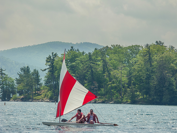 Two men in a small sailboat on Lake George, New York, USA Photograph by Heshphoto