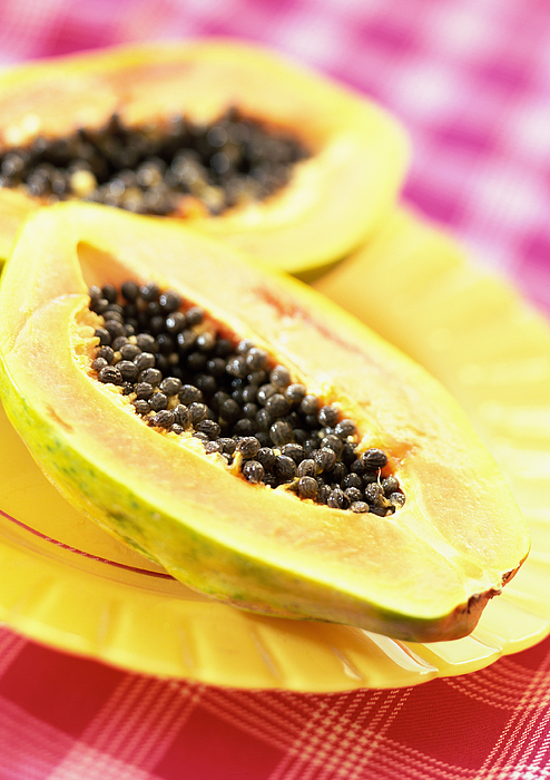 Two Papaya Halves On Yellow Plate, Close-up Photograph by Jean-Blaise Hall