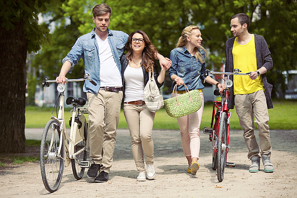 Two Teenage Couples With Bikes Photograph by Efenzi