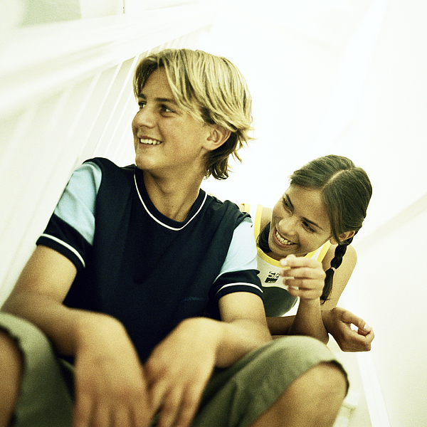 Two teenagers smiling Photograph by Patrick Sheandell OCarroll