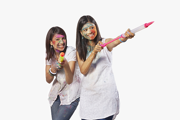 Two women playing holi Photograph by Hemant Mehta