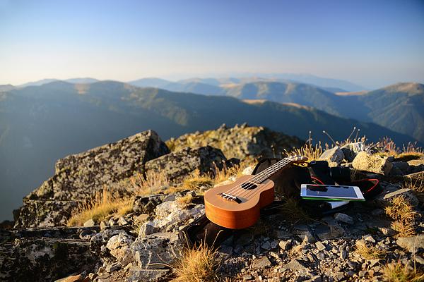 Ukulele resting on a mountain summit Photograph by Maya Karkalicheva