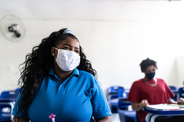 University / high school student wearing face mask while studying in the classroom Photograph by FG Trade