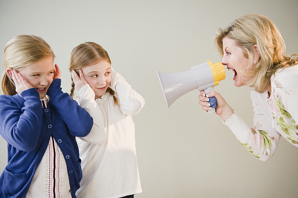USA, Jersey City, New Jersey, mother shouting at daughters (8-11) through bullhorn Photograph by Jamie Grill Photography