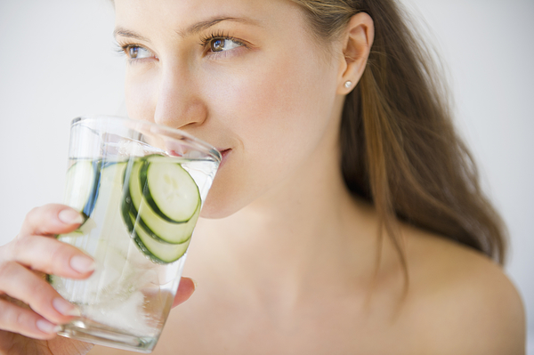 USA, New Jersey, Jersey City, Woman drinking water Photograph by Tetra Images - Jamie Grill