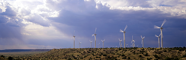 USA, New Mexico, near Fort Sumner, wind generators on mesa Photograph by Timothy Hearsum