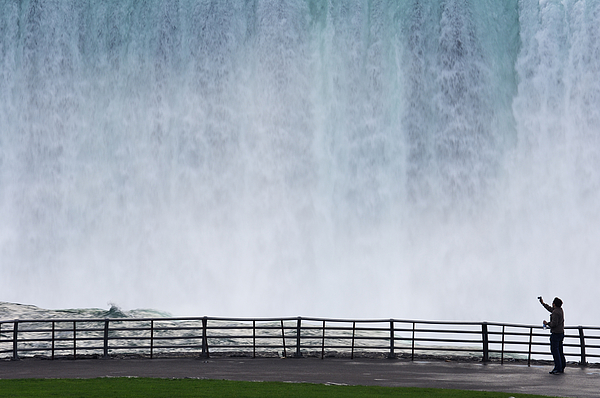 USA, New York State, Ontario, Niagara Falls, man photographing waterfall Photograph by Martin Ruegner