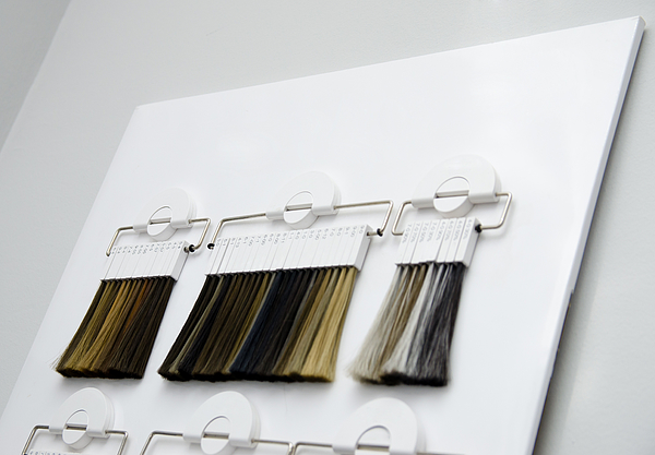 Various Samples Of Hair Coloring On A Special White Stand In The Salon. Hair Dye Color Choice Photograph by Oleg_Chernyavsky