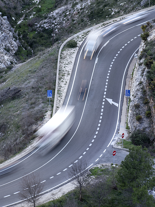 Vehicles in movement in a road with curves Photograph by Jose A. Bernat Bacete
